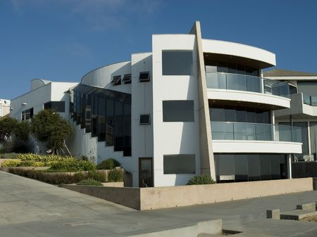 Ultra modern contemporary white house with balconies and landscaping Stock Photo - 1932762