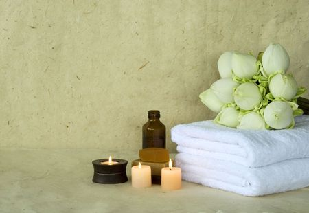 Spa products massage oil with candles and soap with Lotus flowers photo