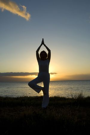 woman in a classic yoga pose at the beach  photo
