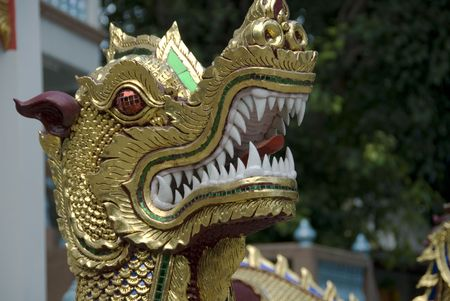 Chinese style dragon at entrance to temple photo