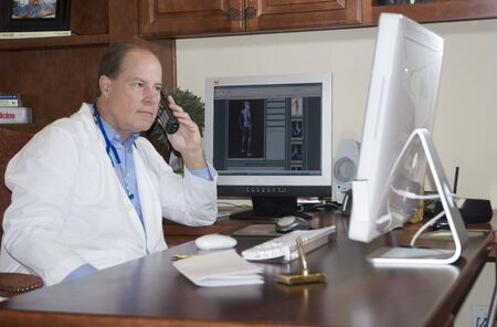 doctor in his office talking on the phone