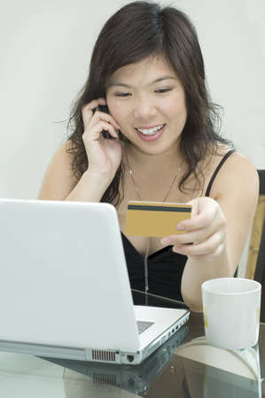 Young woman is contemplating making an online purchase photo