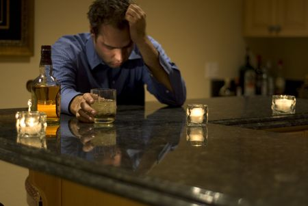 irresponsible: young man drinking and feeling despair Stock Photo