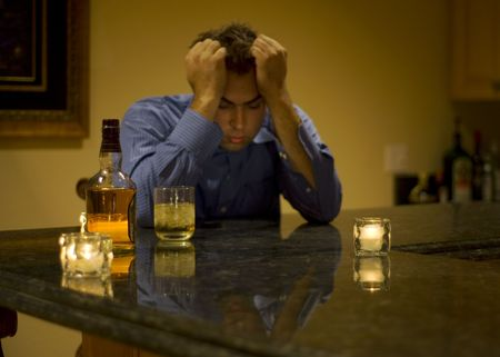 young man drinking and feeling despair Stock Photo - 2298030