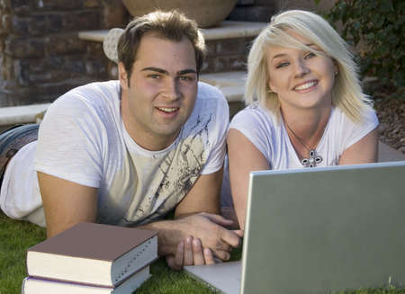 Attractive young couple outdoors with computer Stock Photo - 2317332