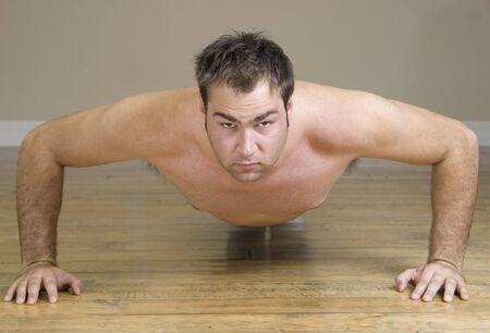 young man doing pushups Stock Photo - 2370077