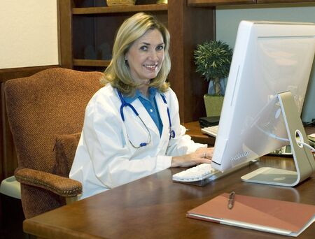 Female Doctor in her office Stock Photo - 2370083
