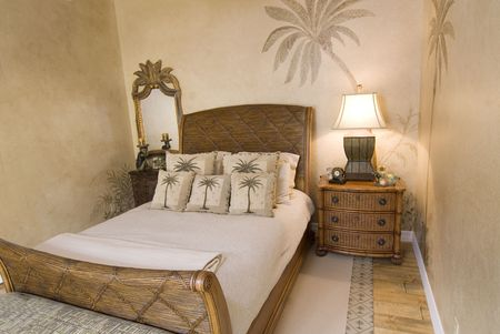 Tropical style rattan bedroom with pillows