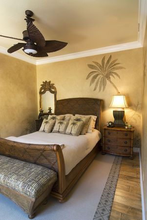 bedroom decorated in tropical style with ceiling fan Stock Photo - 2511069