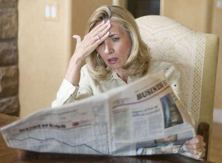 ira: Mature woman reading the financial news