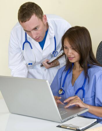 Male doctor and Asian female nurse