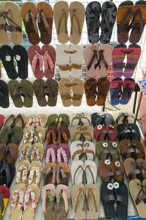 sunday market: display of sandals for sale at the Sunday market in Thailand Stock Photo