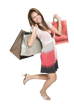 Attractive Asian woman with shopping bags Stock Photo - 3564460