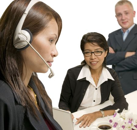 Asian woman and caucasian man with headsets in call center Stock Photo - 3594177