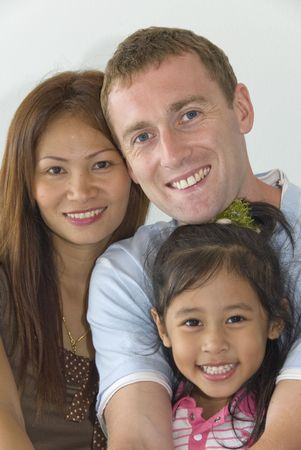 interracial family: young interracial family with child