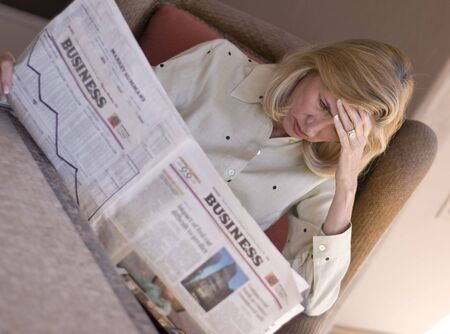 Mature woman reading the financial news