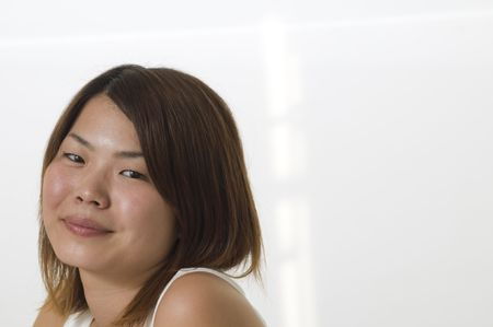 Modern looking Asian woman looking at camera with room for text photo
