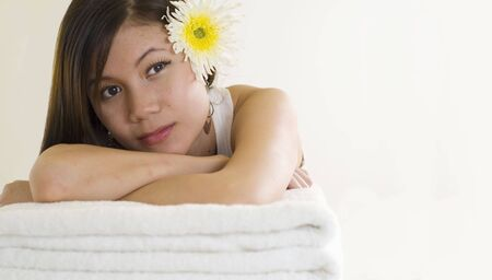 Beautiful sexy young Asian girl relaxing at a spa Stock Photo - 3895418