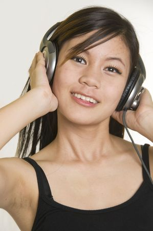 Sexy young girl listening to music on headphones Stock Photo - 3895508