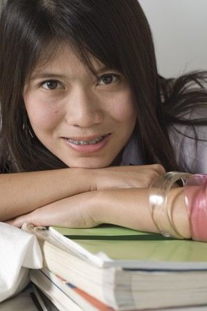 Young attractive female Asian student studying photo