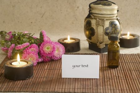 Aromatherapy oil and towels with candles at spa