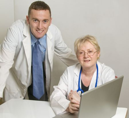 Two medical professionals consulting  photo