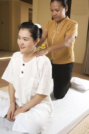 Woman getting Thai massage from professional masseuse Stock Photo