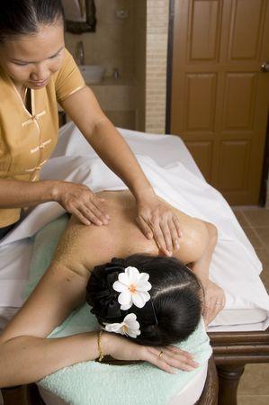 masseuse: Woman getting Thai massage from professional masseuse Stock Photo