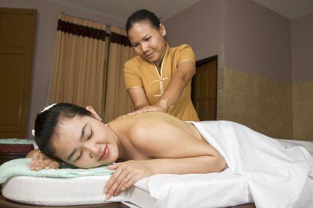 beautycare: Woman getting Thai massage from professional masseuse Stock Photo
