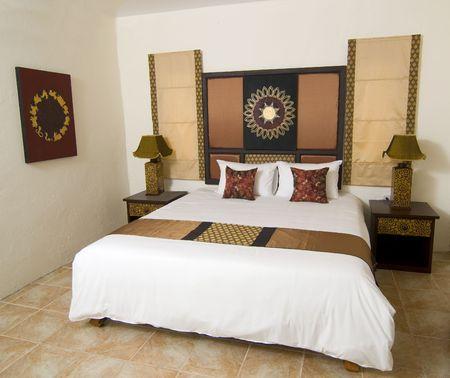 designers interior: Camera da letto in stile tailandese resort