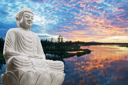 Buddha statue next to sunrise photo