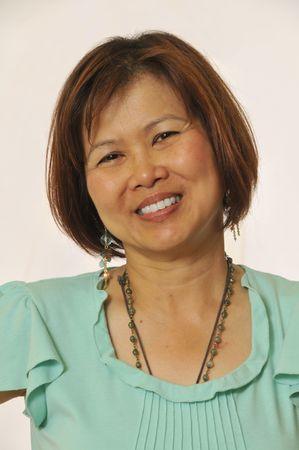 Mature Asian woman looking at camera Stock Photo