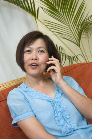 Asian woman talking on the phone photo