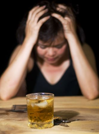 dark portrait of a woman with an alcoholic drink and car keys Stock Photo - 5596965