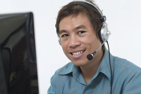 Asian business man wearing headset and smiling