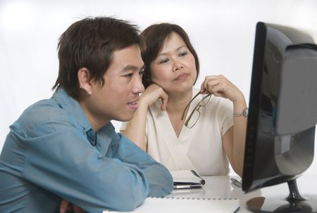 Businesswoman and man looking at computer with selective focus on woman Stock Photo - 5672660
