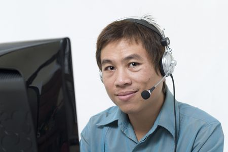 Asian business man wearing headset and smiling Stock Photo - 5721145