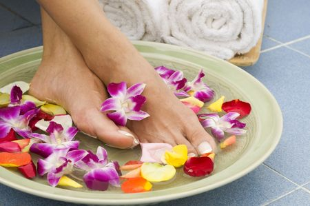 Feet enjoy a relaxing aromatherapy foot spa photo
