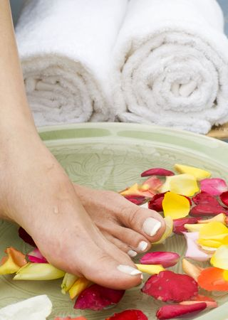 Feet enjoy a relaxing aromatherapy foot spa with Rose petals