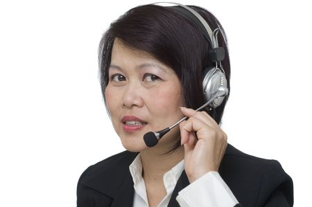 Attractive Asian business woman wearing headset and smiling Stock Photo - 5993598