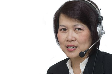 Attractive Asian business woman wearing headset and smiling Stock Photo - 5993604