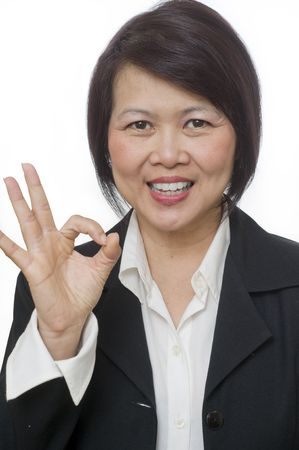 Friendly Asian woman with hand gesture and copy space over white photo