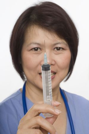 Doctor or Nurse standing with syringe photo