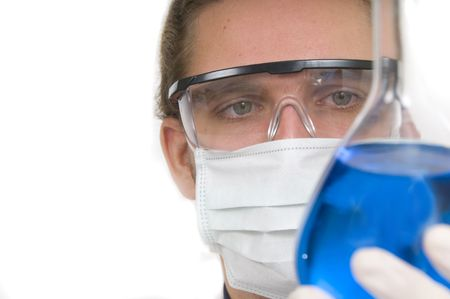 biochemist: Scientist pouring chemicals in a laboratory