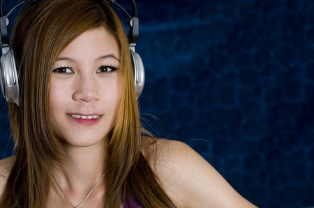 Sexy young girl listening to music on headphones Stock Photo - 7221554