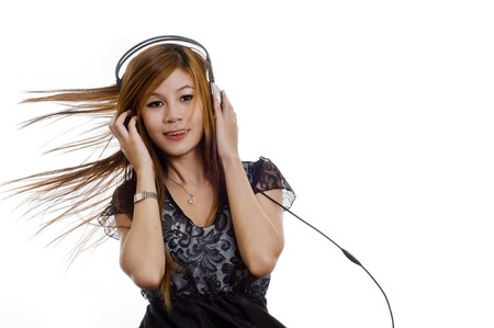 thai dancing: Sexy young girl listening to music on headphones