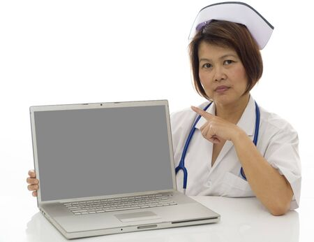 blank screen: Attractive Asian medical professional pointing to blank screen on computer Stock Photo