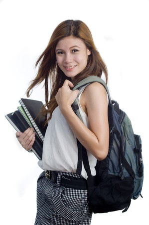 Young attractive female Asian student holding her school books photo