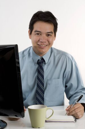 Asian businessman working with computer photo