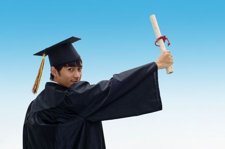 Young man with graduation cap and gown and diploma Stock Photo - 7510355